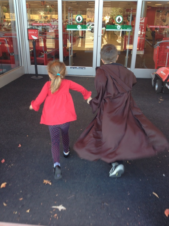 Holding hands...cloak and all.  Bless it.